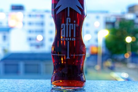 Afri-Cola with lights in the background with macro photographed on 2019-08.08 in Saarbruecken Germany Europe Standard-Bild - 137812234