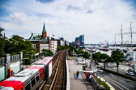 Hamburg harbor with Hochbahn and jetties by day at noon in summer in Germany Europe photographed on 08/16/2015 Standard-Bild - 138470915