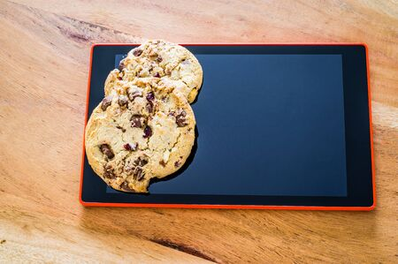 Cookies with a key to illustrate cookie banners for websites Banco de Imagens