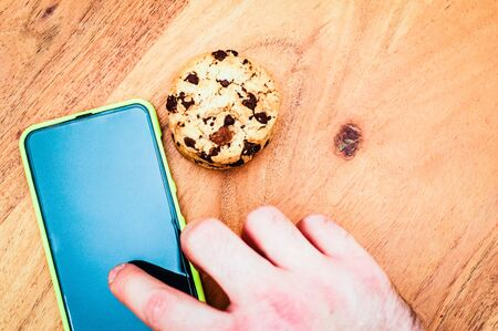 Accept cookies with a tablet to illustrate cookie banners for websites with cookies Banco de Imagens