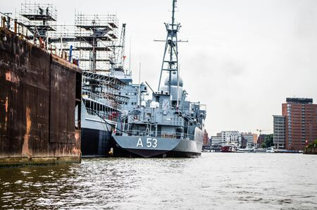 Hamburg harbor and jetties with German warships A53 Oker and A1443 Rhön and photographed in Germany Europe on 08.15.2015 Editorial