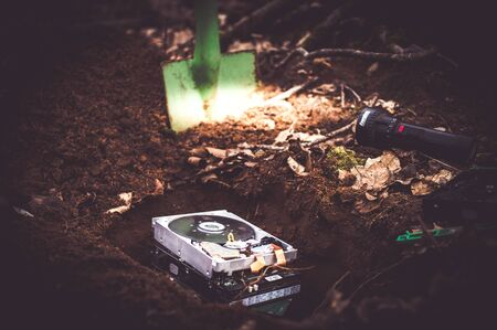 Hard disk buried in the forest to clarify a data protection problem in the event of data carrier destruction Standard-Bild - 142834277