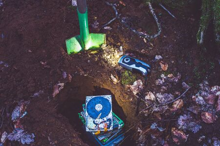 Hard disk buried in the forest to clarify a data protection problem in the event of data carrier destruction