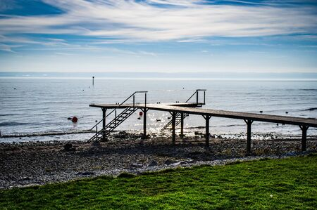 Boat dock on Lake Constance with a view of the Alps