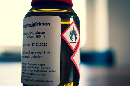 Bottle of a disinfectant with instructions for use in German in German Disinfection in English disinfection