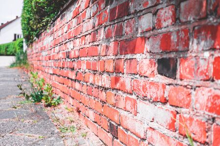 Brick wall of a front yard wall in a residential area in red with artistic optics Standard-Bild - 144587383