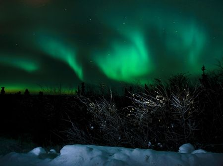 The aurora borealis as seen north of Fairbanks, Alaska during a highly active night. Reklamní fotografie