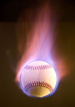 A flaming baseball, fire mostly going up.