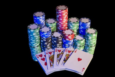 jack pot: Royal Flush, hearts, with chips. Blue lighting from left hand side, isolated on black.