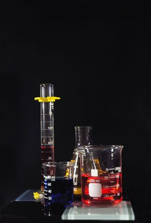 Several beakers with colored chemicals