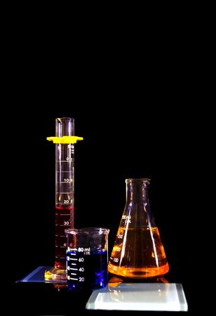 Beakers and a flask against a black background Stock Photo