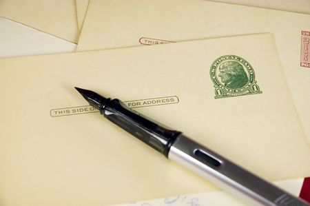 Fountain pen with antique cards with postage