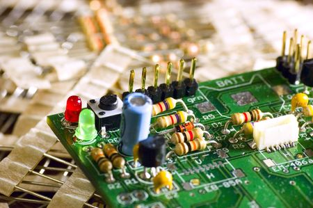 Circuit board over pile of resistors