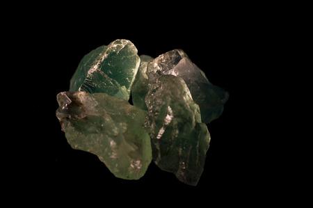 side lighting: Light green fluorite crystals under side lighting