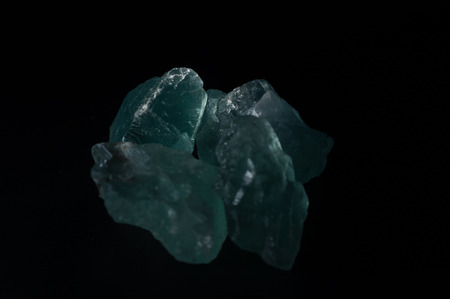 fluorite: Blue-green fluorite crystals prior to faceting.