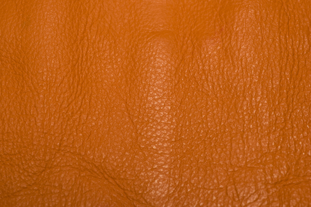 Orange leather showing surface details and creases.