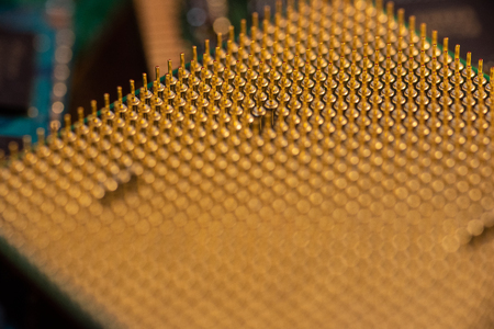 Pin grid array on a CPU showing rows of golden pins. Reklamní fotografie