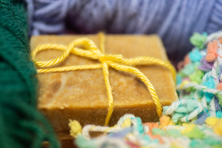 Bars of hand crafted soap with yarn.
