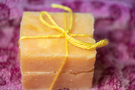 Two bars of hand crafted soap tied with a bow.