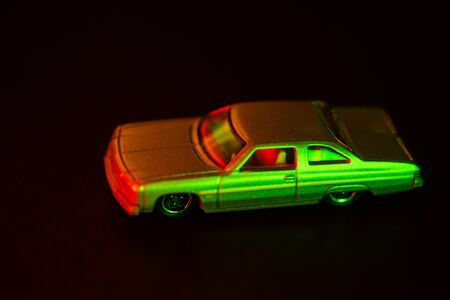 A toy car under red and green light.