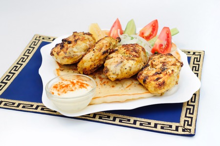 Greek grill meatball on pita with tomato and cucumbers Reklamní fotografie