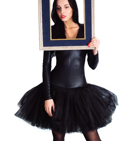 Woman wearing in black dress holding picture frame, Isolate