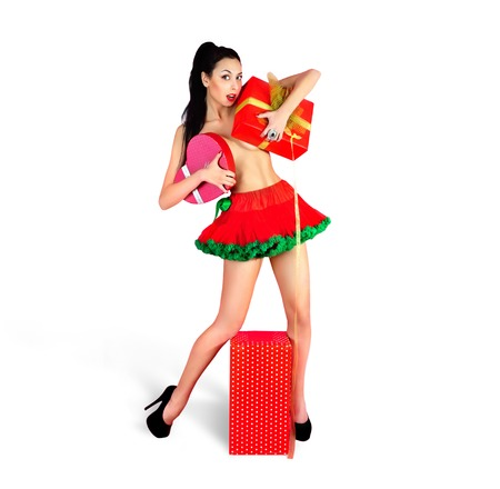 Splendid brunette, naked girl with red gift boxes in Valentine day, studio shot - series of photos. Isolated on white.