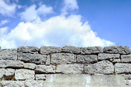 gothic build: Sky and Stone wall background. Many stones. Stock Photo