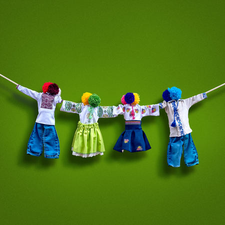 Handmade textile dolls on background, traditional ukrainian folk rag doll Motanka in ethnic style, ancient culture folk crafts tradition of Ukraine. Most Popular Souvenirs From Ukraine.