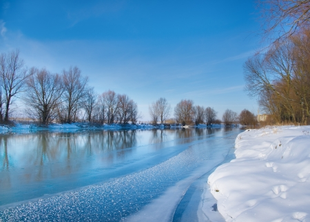 frozen river: snow-covered winter river