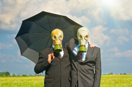 Two men in gas-mask on meadow  Conceptual composition  photo