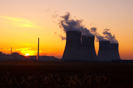 Nuclear power plant at sunset  photo