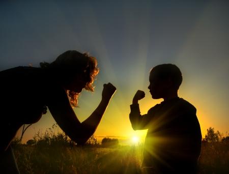 temper: Son shows temper of mother Stock Photo