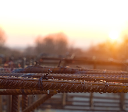 armature: Armature is tied under the concrete foundation at sunset