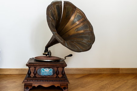 An old object for home. A gramophone, a vintage instrument for classical music. Stock Photo