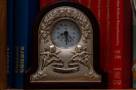 A metal clock and some signs of aging, to indicate that there is always time for books. A good read is always synonymous with great knowledge.