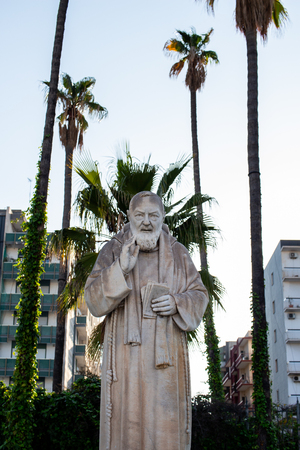 Bari, Italy - 04 22 2018: Statue of Padre Pio in the city of Bari, Italy, built in front of the hospital. A symbol of faith to protect the sick. Editorial