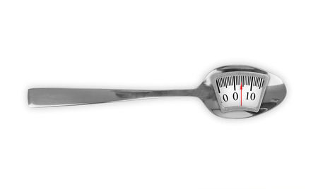 Metal spoon with weight scale Stock Photo