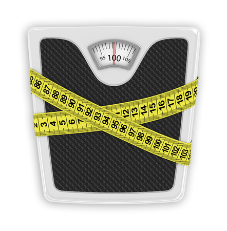 healt: Measuring tape wrapped around bathroom scales Stock Photo