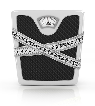 Measuring tape wrapped around bathroom scales  Concept of weight loss, diet, unhealthy lifestyle  photo