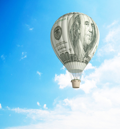 high rise: Hot air balloon with 100 dollar banknote