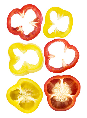 Set of sliced red, yellow bell pepper section pieces isolated over white background Stock Photo