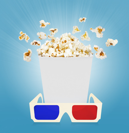 popcorn with glasses  blue background photo
