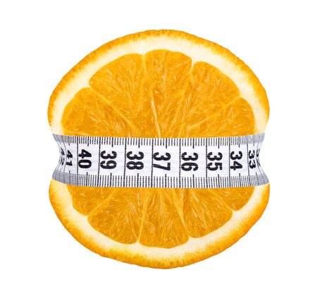Orange slice with measurement isolated on white photo