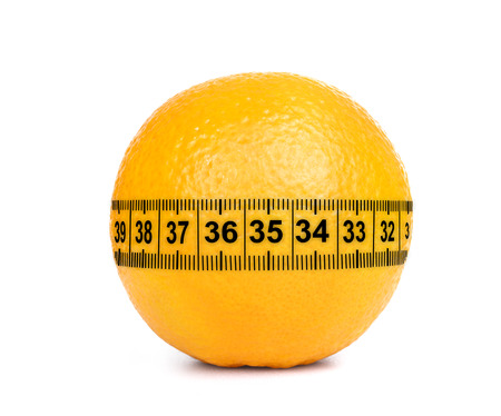 Orange Fruit with measurement isolated on white photo