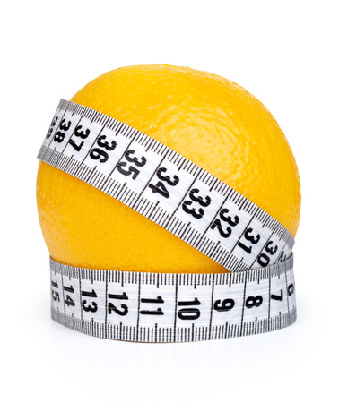 Orange fruit with tape measure photo