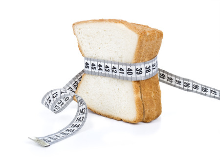 Piece of bread grasped by measuring tape Stock Photo - 28281637