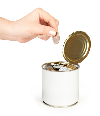 wor: hand put coin in tin with coins Stock Photo