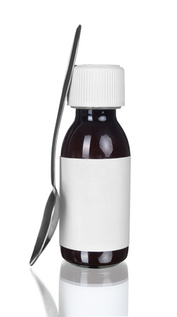 Plain label glass medicine bottle with spoon ready to put text or picture on it for your advertisement photo