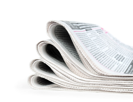 newspaper stack: newspapers on white background Stock Photo